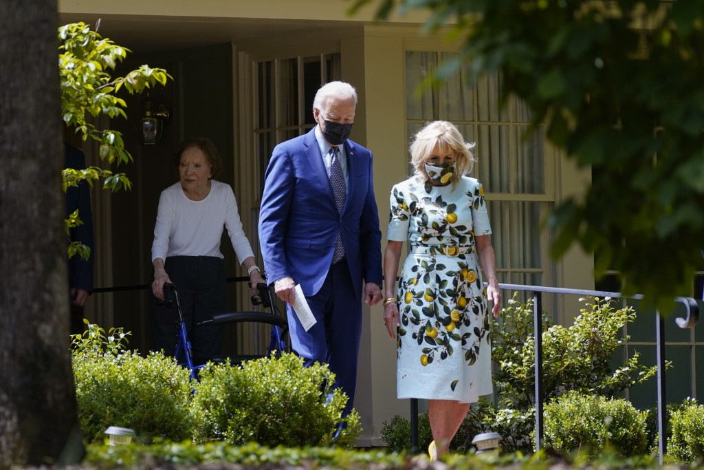 President Joe Biden and first lady Jill Biden walk with former first lady Rosalynn Carter as they leave the home of former President Jimmy Carter duri...