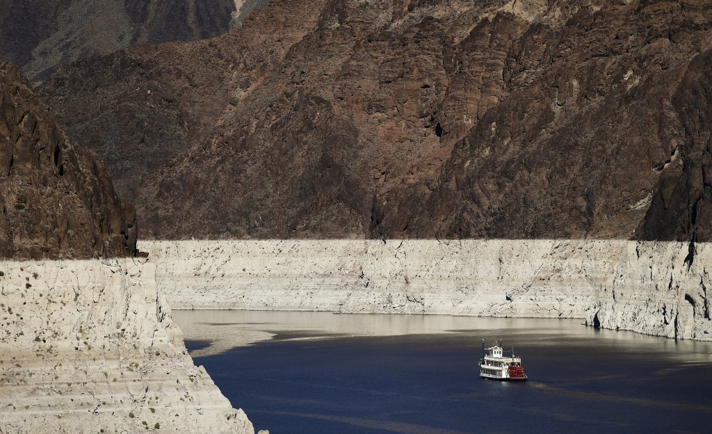 FILE - In this Oct. 14, 2015, file photo, a riverboat glides through Lake Mead on the Colorado River at Hoover Dam near Boulder City, Nev. Water offic...