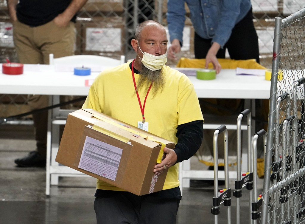 A box of Maricopa County ballots cast in the 2020 general election are delivered to be examined and recounted by contractors working for Florida-based...