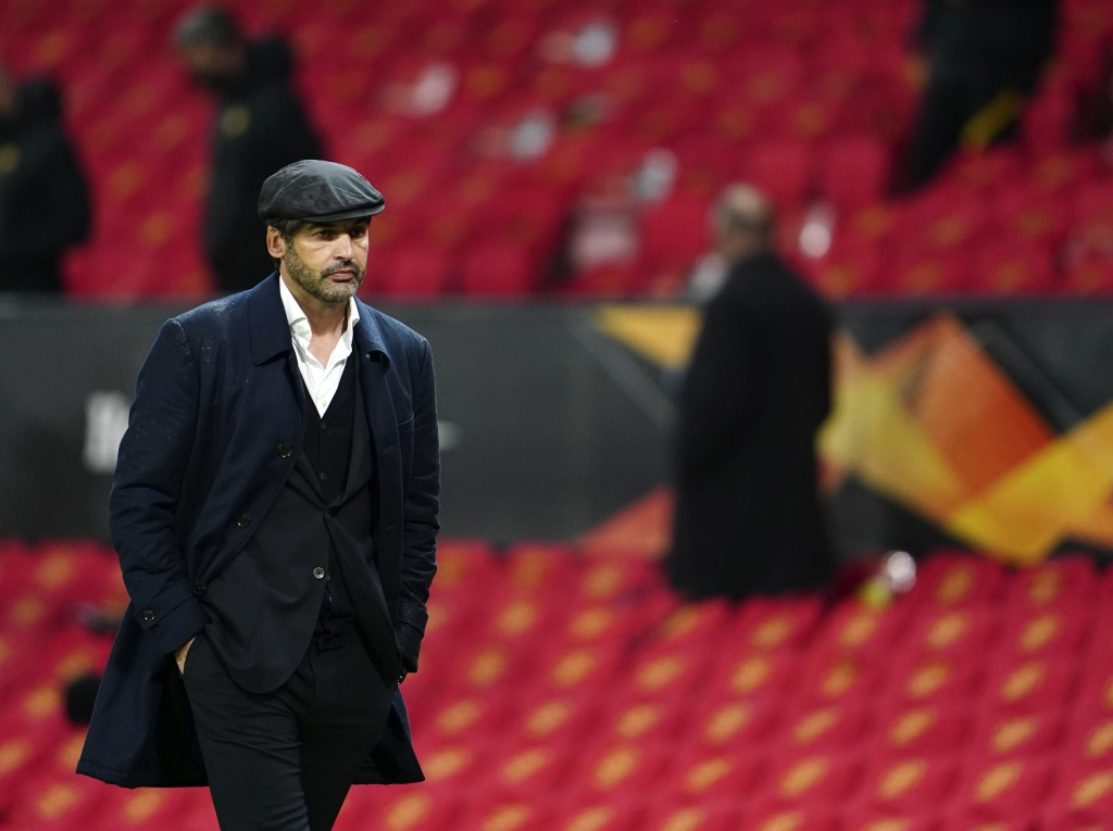 Roma's head coach Paulo Fonseca leaves the pitch at half time of the Europa League semi final, first leg soccer match between Manchester United and Ro...