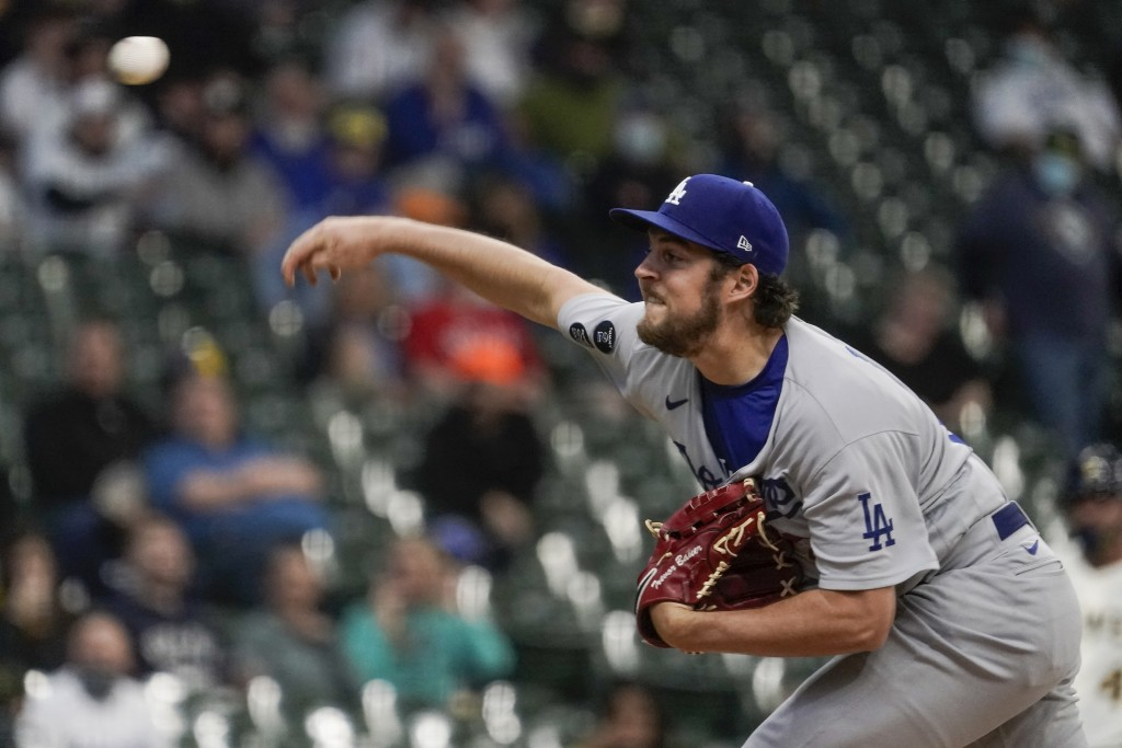 Los Angeles Dodgers starting pitcher Trevor Bauer throws during the first inning of a baseball game against the Milwaukee Brewers Thursday, April 29, ...