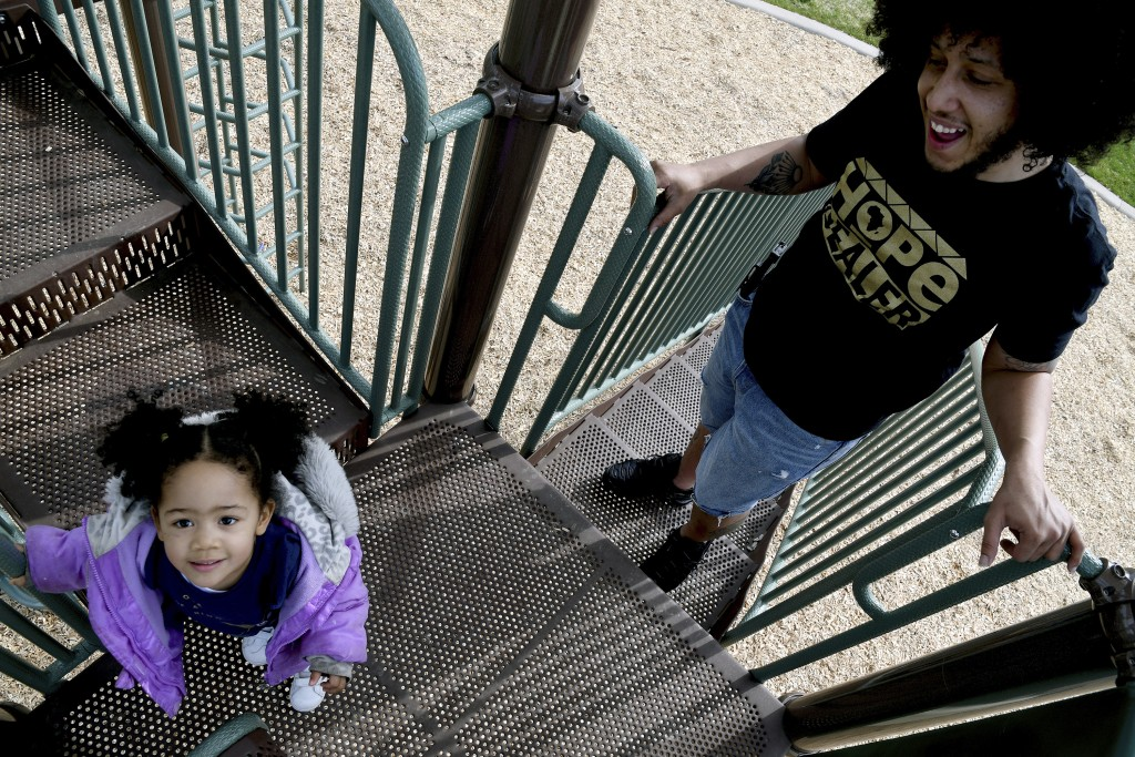 Michael Diaz-Rivera plays with his 2-year-old daughter Aria at a Denver park on Friday, April 23, 2021. Diaz-Rivera was pulled over in Colorado Spring...
