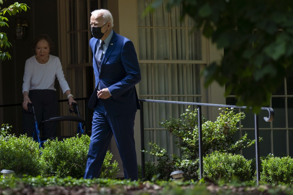 Former first lady Rosalynn Carter looks on as President Joe Biden leaves the home of former President Jimmy Carter during a trip to mark Biden's 100th...