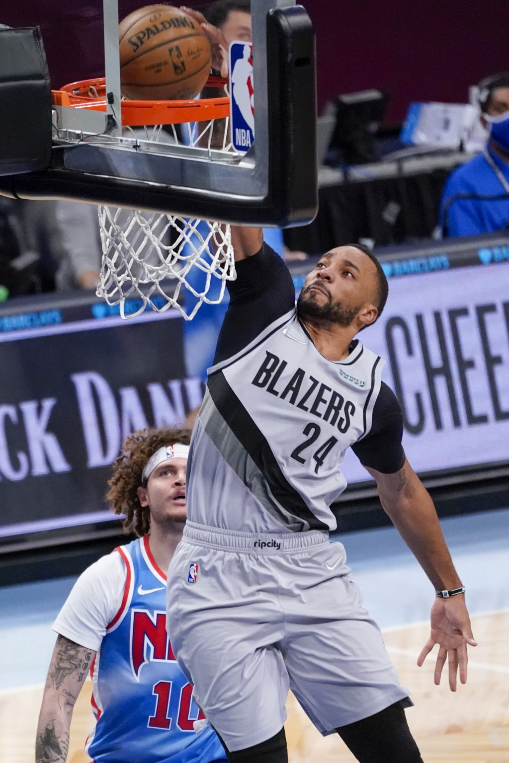 Portland Trail Blazers forward Norman Powell (24) dunks during the second half of an NBA basketball game against the Brooklyn Nets, Friday, April 30, ...