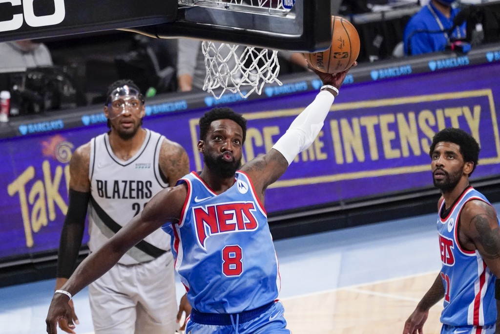 Brooklyn Nets forward Jeff Green dunks during the first half of the team's NBA basketball game against the Portland Trail Blazers, Friday, April 30, 2...