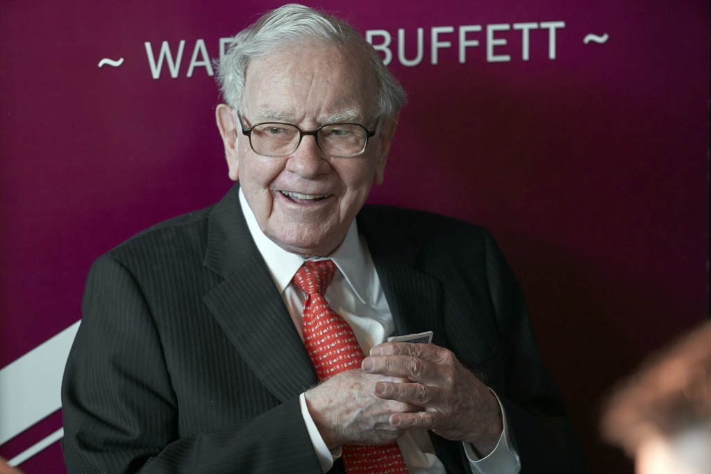 FILE - In this May 5, 2019, file photo Warren Buffett, Chairman and CEO of Berkshire Hathaway, smiles as he plays bridge following the annual Berkshir...