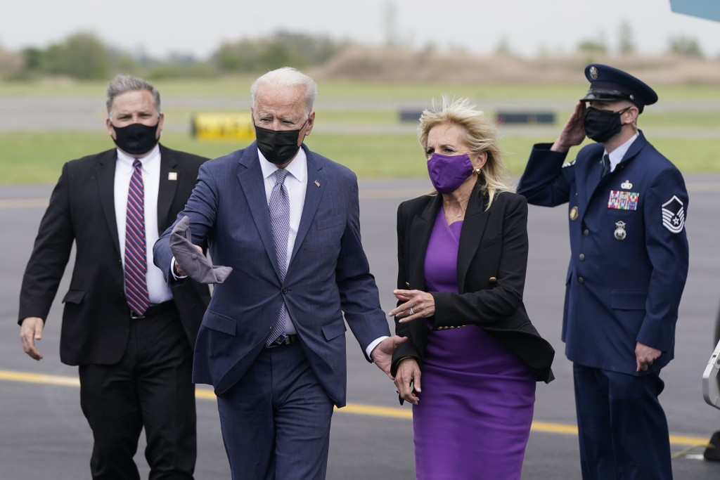 President Joe Biden and first lady Jill Biden walk to a motorcade vehicle after stepping off Air Force One at Philadelphia International Airport in Ph...