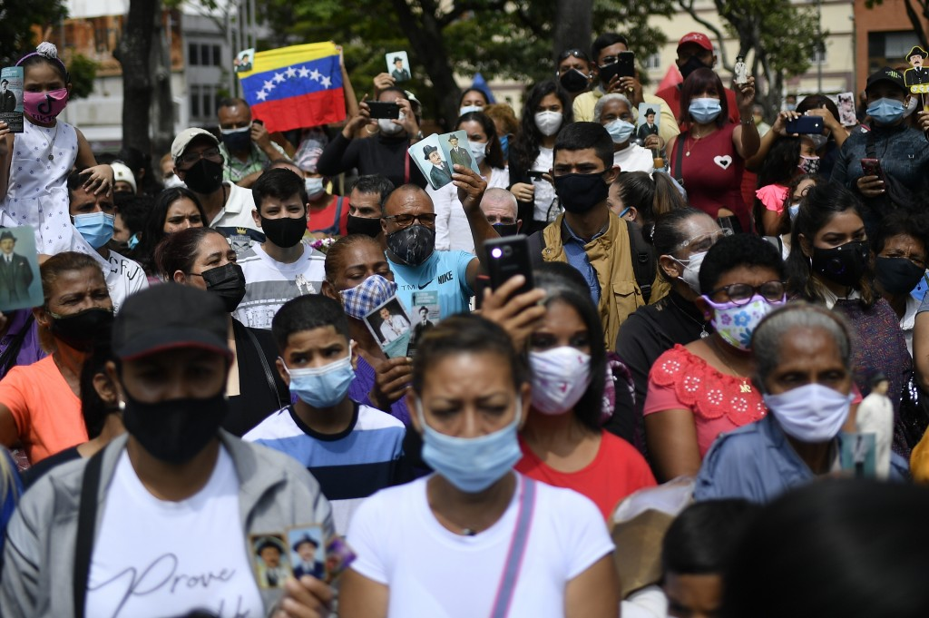 People gather outside the church associated with the remains of Venezuelan Dr. Jose Gregorio Hernandez during his geatification ceremony in Caracas, V...