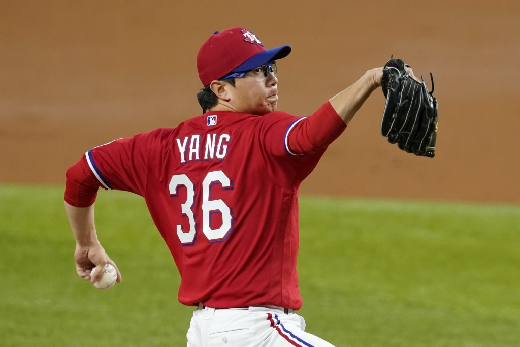 Texas Rangers relief pitcher Hyeon-Jong Yang throws to a Boston Red Sox batter during the third inning of a baseball game in Arlington, Texas, Friday,...