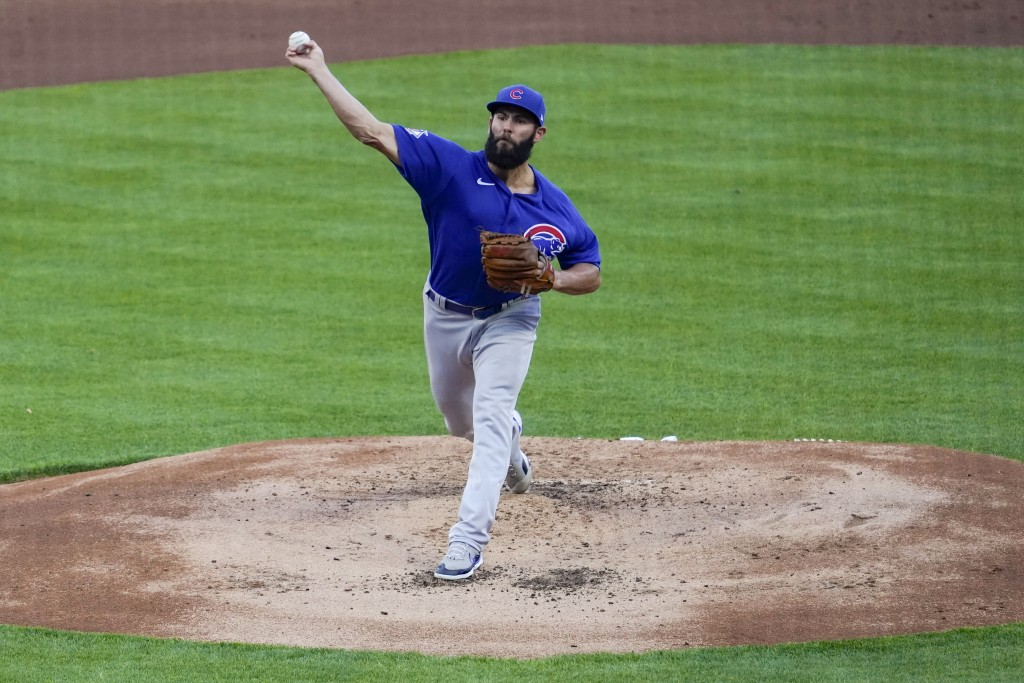 Chicago Cubs starting pitcher Jake Arrieta throws during the first inning of the team's baseball game against the Cincinnati Reds on Friday, April 30,...