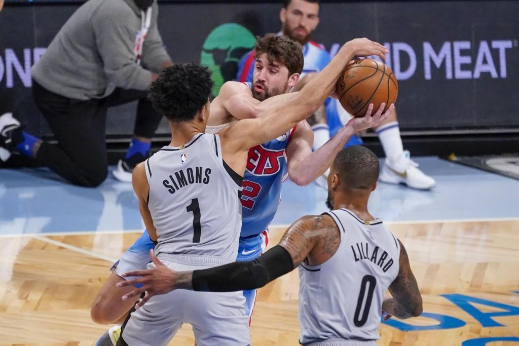Portland Trail Blazers guards Anfernee Simons (1) and Damian Lillard (0) guard against Brooklyn Nets forward Joe Harris (12) during the first half of ...