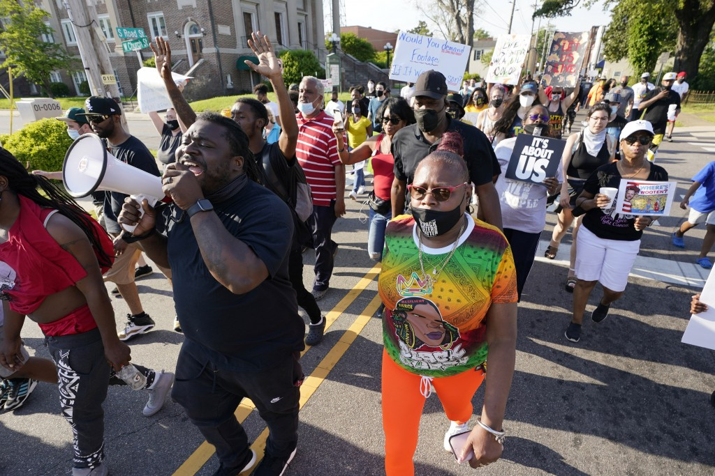 FILE - In this April 28, 2021 file photo, protesters march along the streets to protest the shooting of Andrew Brown Jr. in Elizabeth City, N.C. The f...