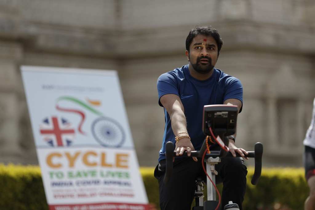 "A man takes part in ""Cycle to Save Lives"" a 48 hour, non-stop static relay cycle challenge at the BAPS Shri Swaminarayan Mandir, also know as the Neas..."
