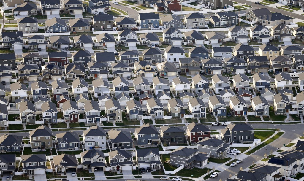 FILE - Rows of homes, are shown in suburban Salt Lake City, on April 13, 2019. Utah is one of two Western states known for rugged landscapes and wide-...