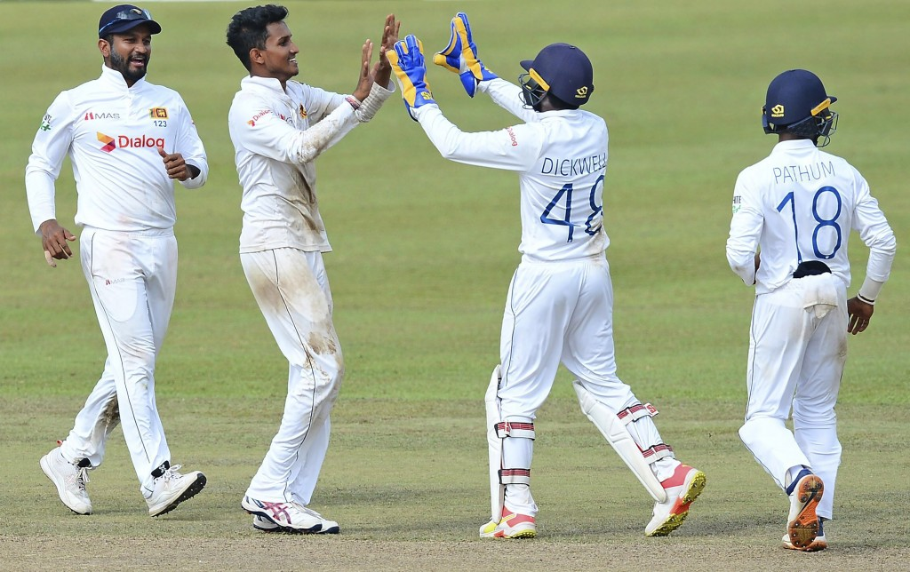 Sri Lanka's Praveen Jayawickrama, second left, celebrates with teammates the dismissal of Bangladesh's Mehidy Hasan during the third day of the second...