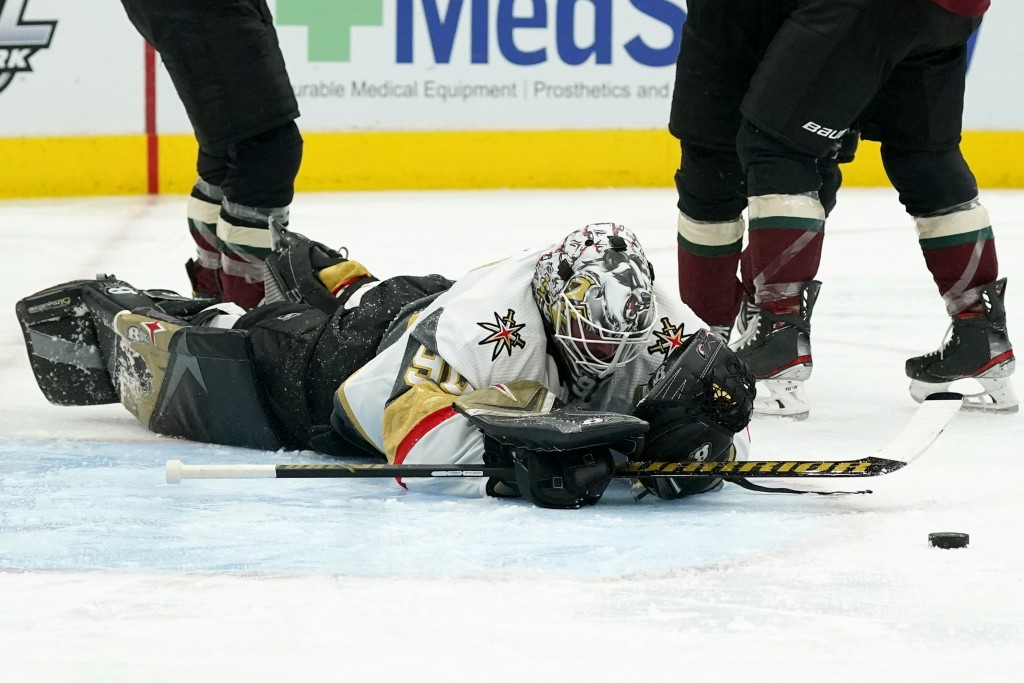 Vegas Golden Knights goaltender Robin Lehner pauses on the ice after giving up a goal to Arizona Coyotes' Michael Bunting during the third period of a...