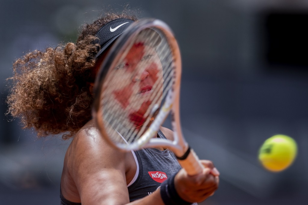 Japan's Naomi Osaka returns the ball to Japan's Misaki Doi during their match at the Mutua Madrid Open tennis tournament in Madrid, Spain, Friday, Apr...