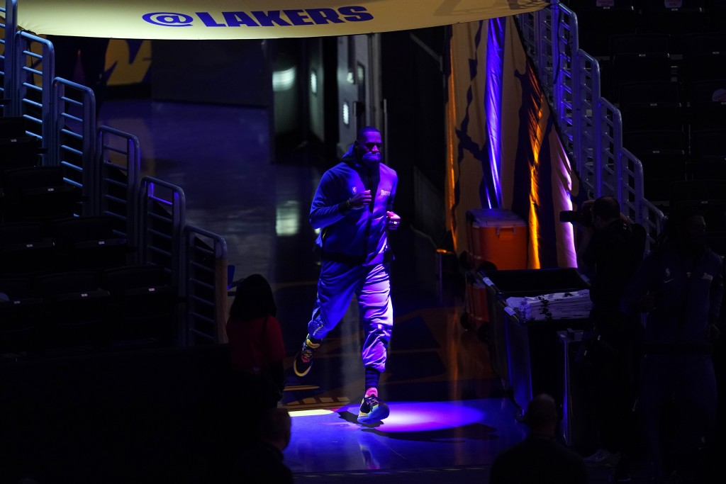 Los Angeles Lakers' LeBron James enters the court for warmups before an NBA basketball game against the Sacramento Kings, Friday, April 30, 2021, in L...