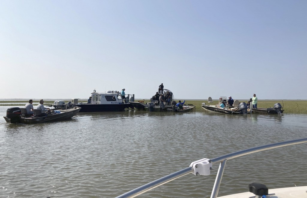 Volunteers on boats gather on Thursday, April 29, 2021, on the water along the Louisiana coast before setting out to look for survivors of the Seacor ...