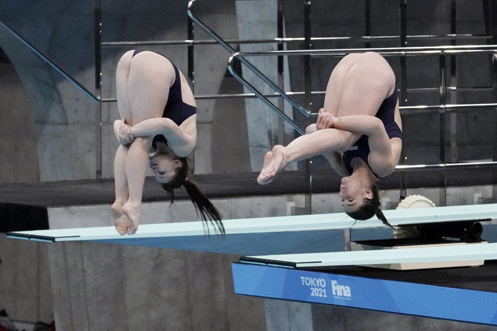 Elena Bertocchi and Chiara Pellacani of Italy perform a dive during the women's synchronized 3-meter springboard finals at the FINA Diving World Cup S...