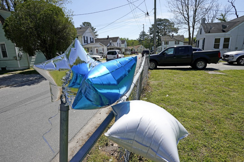 FILE - In this April 22, 2021 file photo, balloons are seen tied to a fence in Elizabeth City, N.C. The fatal shooting of a Black man by sheriff's dep...