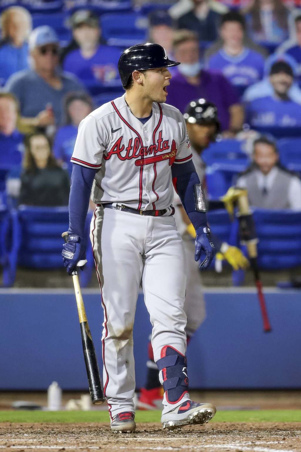 Atlanta Braves' Alex Jackson reacts to being called out on strikes against the Toronto Blue Jays during the sixth inning of a baseball game Friday, Ap...