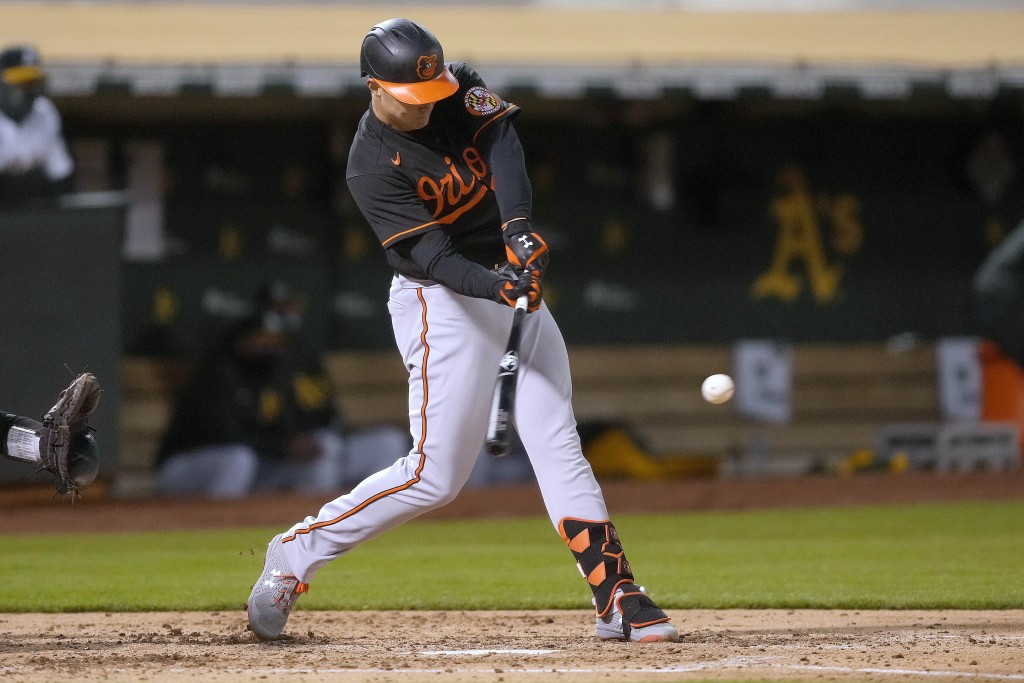 Baltimore Orioles' Ryan Mountcastle hits a single against the Oakland Athletics during the sixth inning of a baseball game Friday, April 30, 2021, in ...
