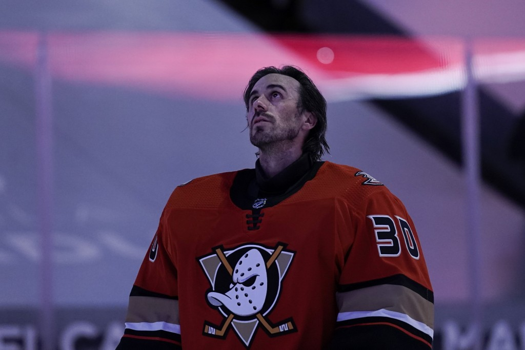 Anaheim Ducks goaltender Ryan Miller listens to the national anthem before the team's NHL hockey game against the Los Angeles Kings, Saturday, May 1, ...