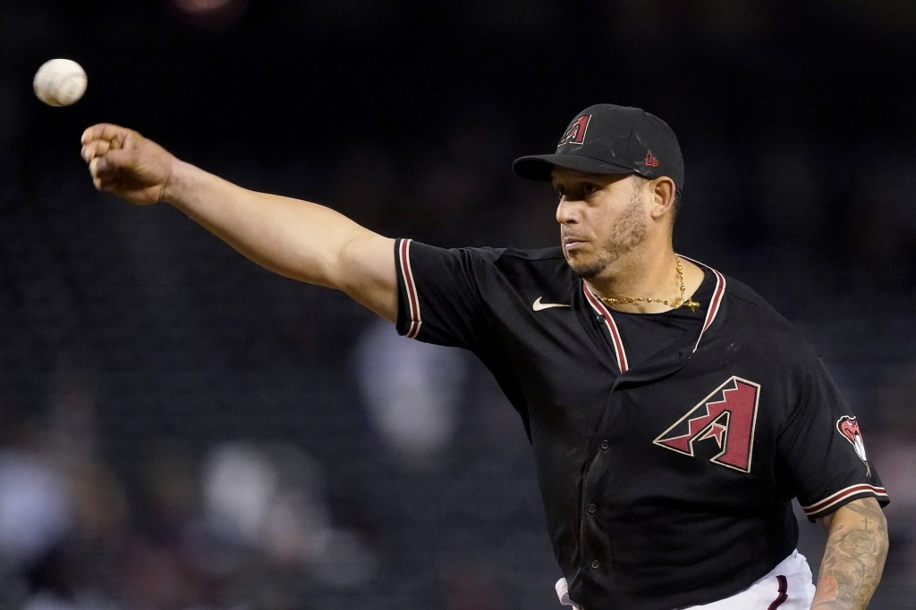 Arizona Diamondbacks' Asdrubal Cabrera throws in relief during the eighth inning of a baseball game against the Colorado Rockies, Saturday, May 1, 202...