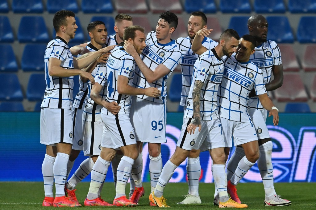 Inter Milan's Christian Eriksen, fourth form left, celebrates after scoring his side's first goal during the Italian Serie A soccer match between Crot...