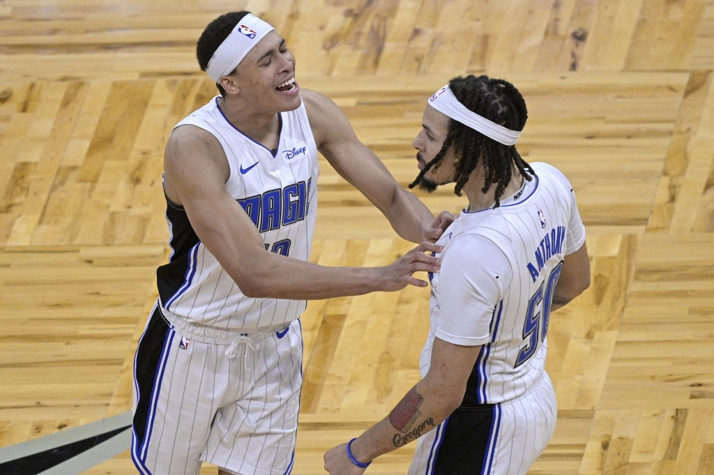 Orlando Magic guard Cole Anthony (50) is congratulated by guard R.J. Hampton after scoring the winning basket during the second half of an NBA basketb...
