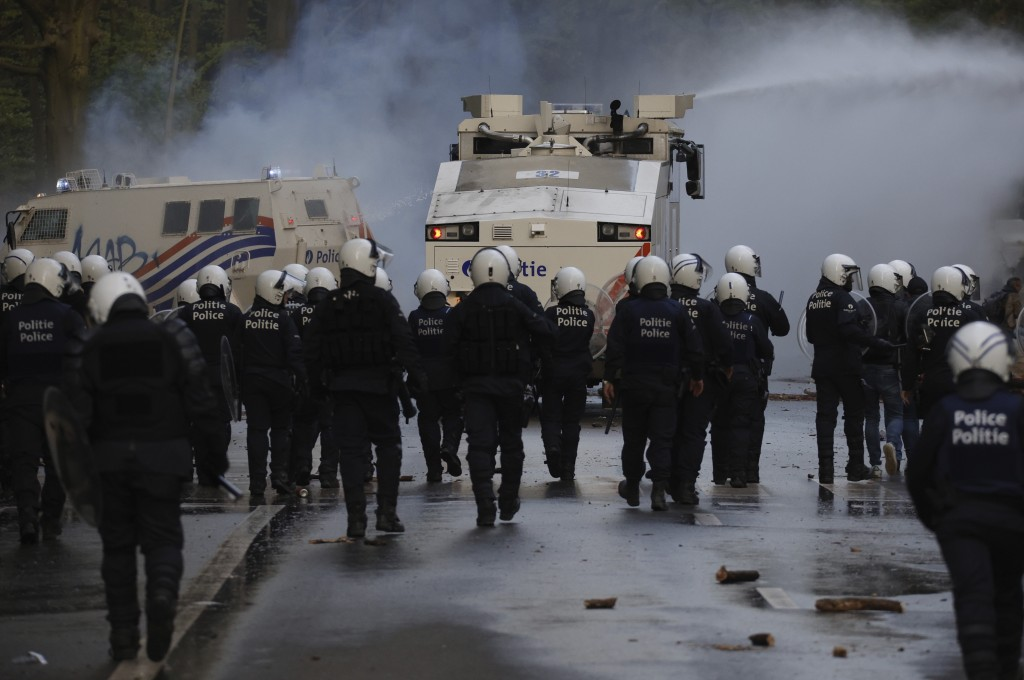 """Police disperse protestors with a water cannon at the Bois de la Cambre park during a party called """"La Boum 2"""" in Brussels, Saturday, May 1, 2021. A f..."""