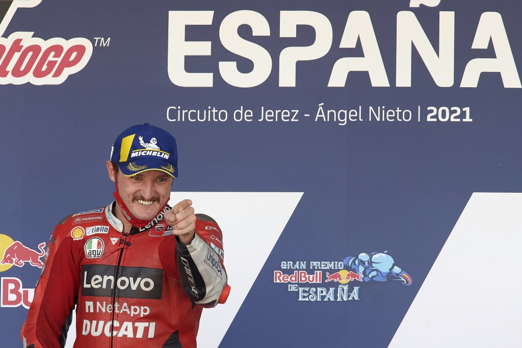 Australian rider Jack Miller celebrates his victory on the podium after the MotoGP Spanish Motorcycle Grand Prix at the Angel Nieto racetrack in Jerez...