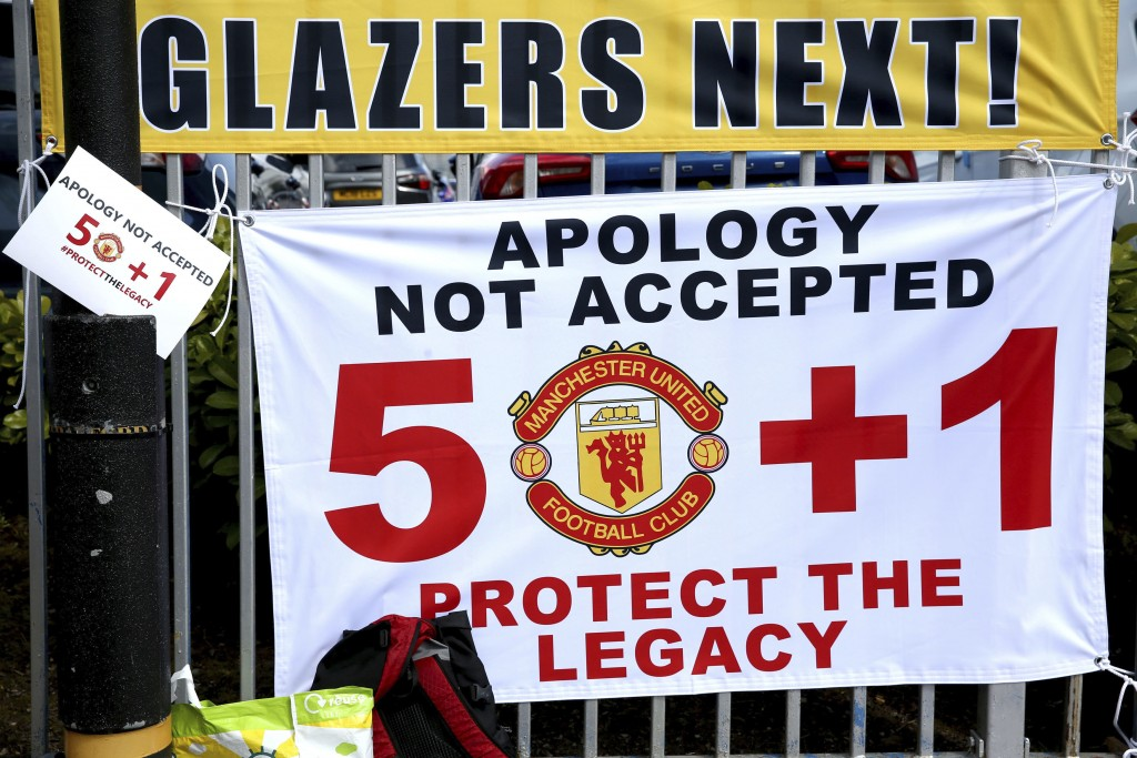 Banners near the stadium as fans protest against the Glazer family, owners of Manchester United, before their Premier League match against Liverpool a...