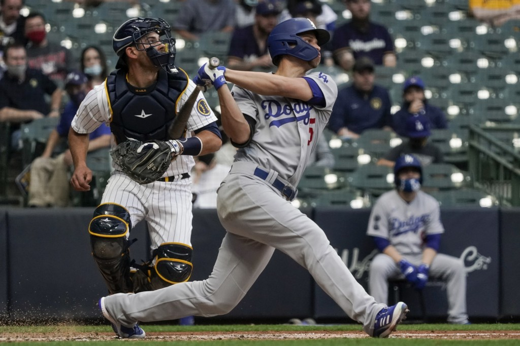 Los Angeles Dodgers' Corey Seager hits an RBI triple during the third inning of a baseball game against the Milwaukee Brewers Saturday, May 1, 2021, i...