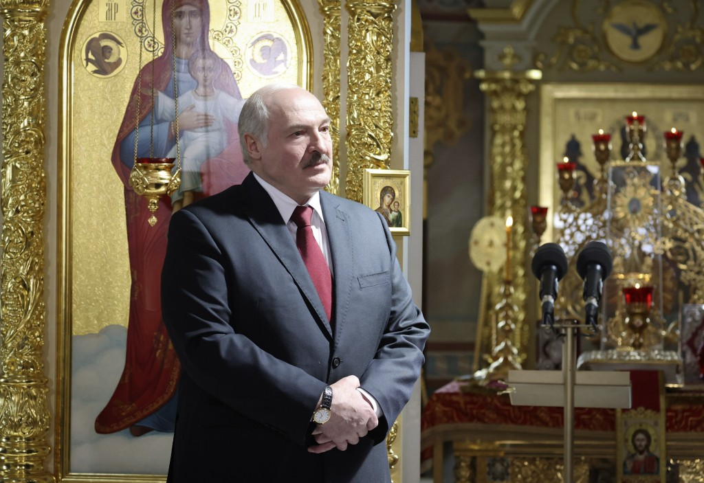 Belarusian President Alexander Lukashenko, left, attends the Orthodox Easter service in the town of Turov, some 270 km (167 miles) south of Minsk, Bel...