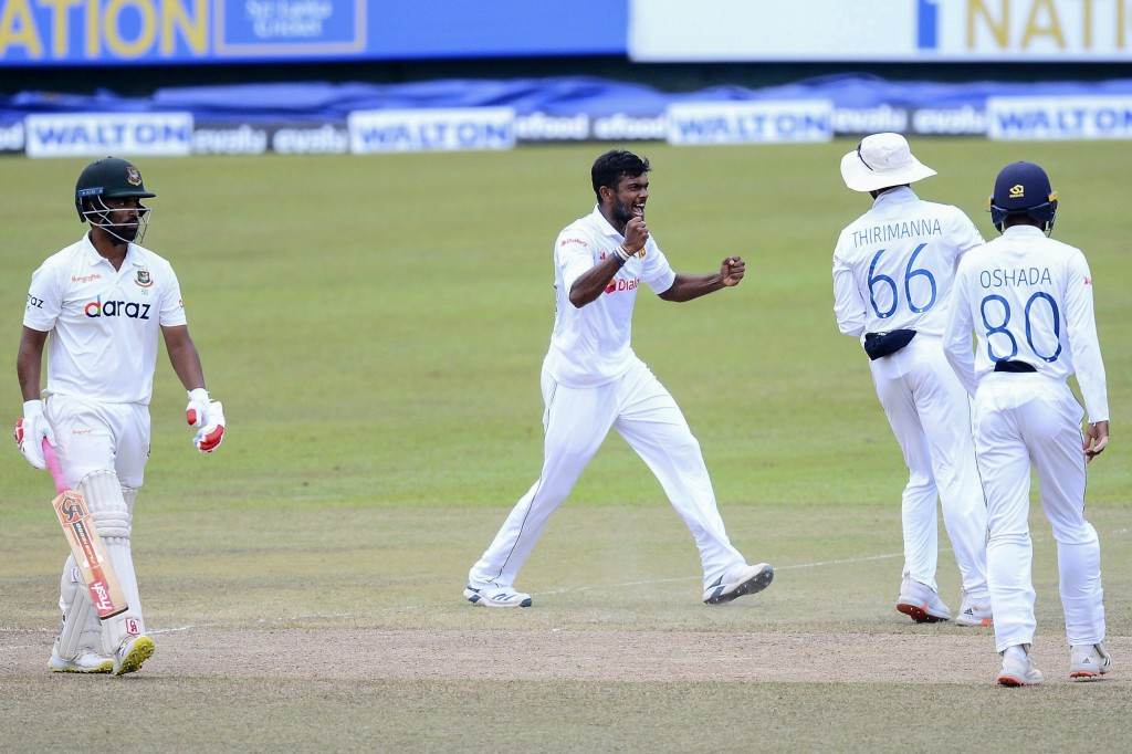 Sri Lanka bowler, Ramesh Mendis, second left, celebrates the wicket of Bangladeshi batsman, Tamim Iqbal, left during the fourth day of the second test...