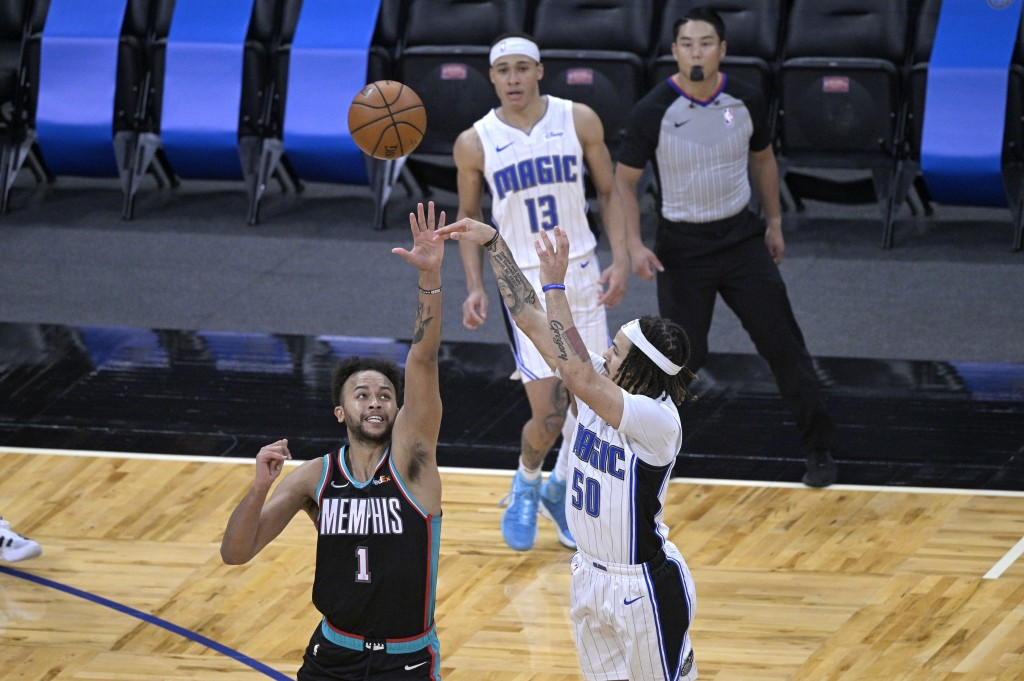 Orlando Magic guard Cole Anthony (50) hits the winning basket in front of Memphis Grizzlies forward Kyle Anderson (1) during the second half of an NBA...