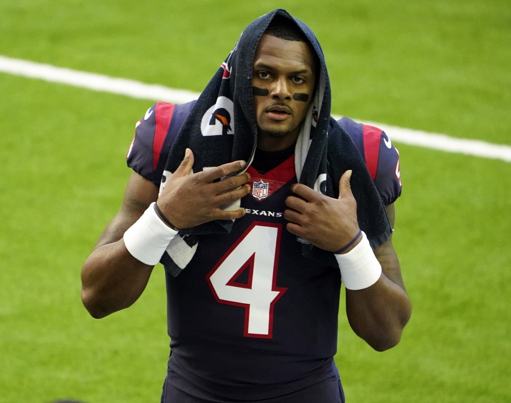 FILE - In this Jan. 3, 2021, file photo, Houston Texans quarterback Deshaun Watson walks off the field before an NFL football game against the Tenness...