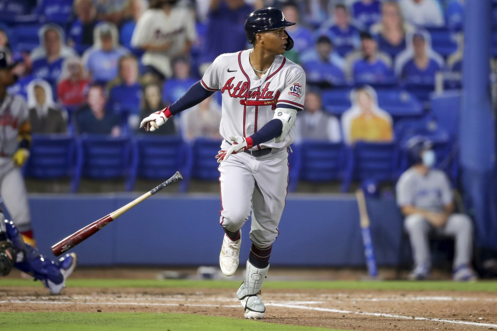 Atlanta Braves Cristian Pache watches his grand slam home run against the Toronto Blue Jays during the second inning of a baseball game Saturday, May ...