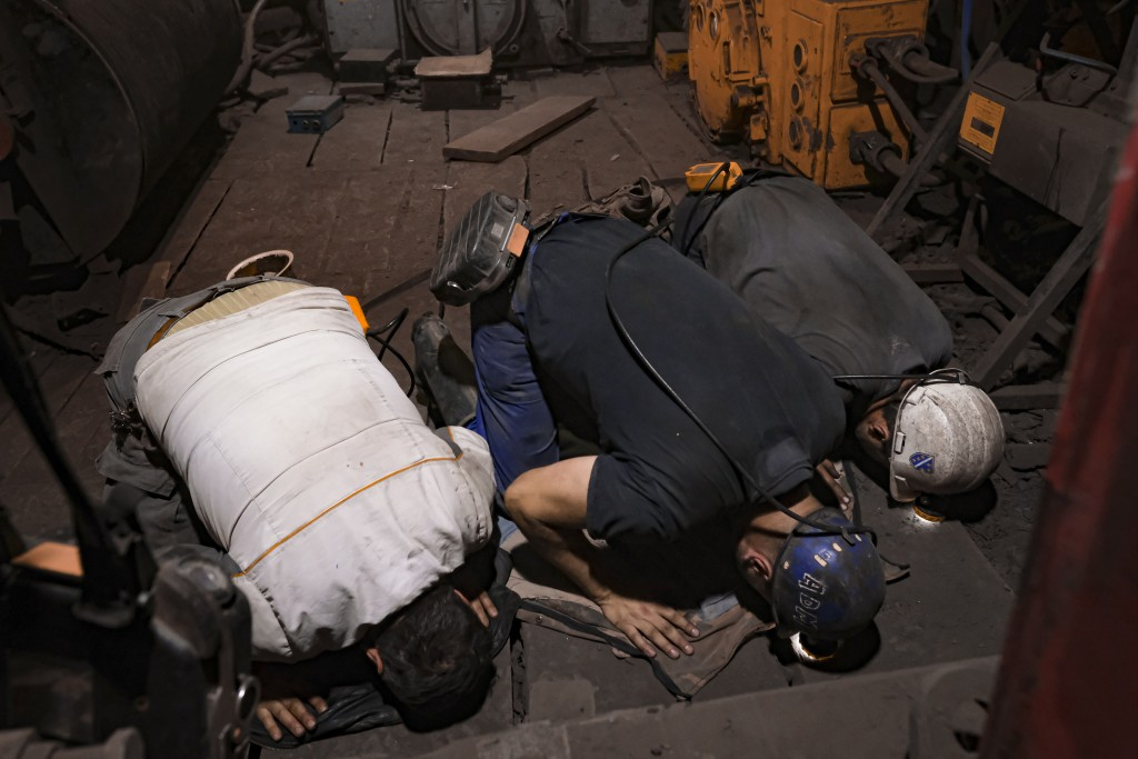 Bosnian coal miners pray after breaking fast in the underground at a mine in Zenica, Bosnia, Thursday, April 29, 2021. After a quick meal, one of the ...