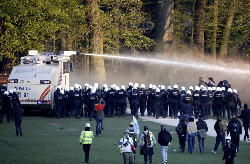 """Police use a water cannon against protestors at the Bois de la Cambre park during a party called """"La Boum 2"""" in Brussels, Saturday, May 1, 2021. A few..."""