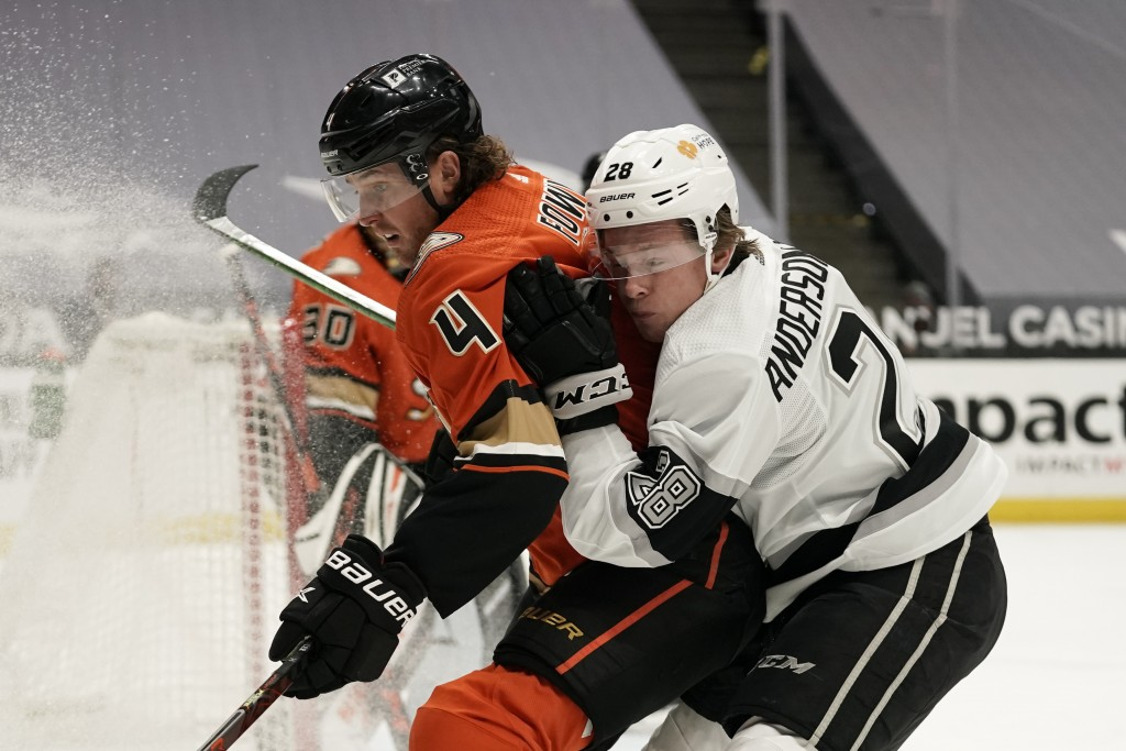 Los Angeles Kings' Jaret Anderson-Dolan, right, collides with Anaheim Ducks' Cam Fowler during the first period of an NHL hockey game Saturday, May 1,...
