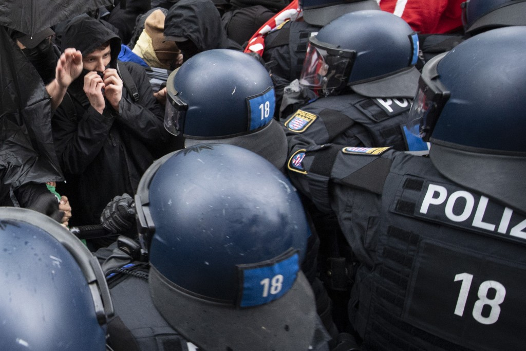 "Police and demonstrators clash during the ""Revolutionary May Day Demonstration"" in Frankfurt Saturday, May 1, 2021. (Boris Roessler/dpa via AP)"