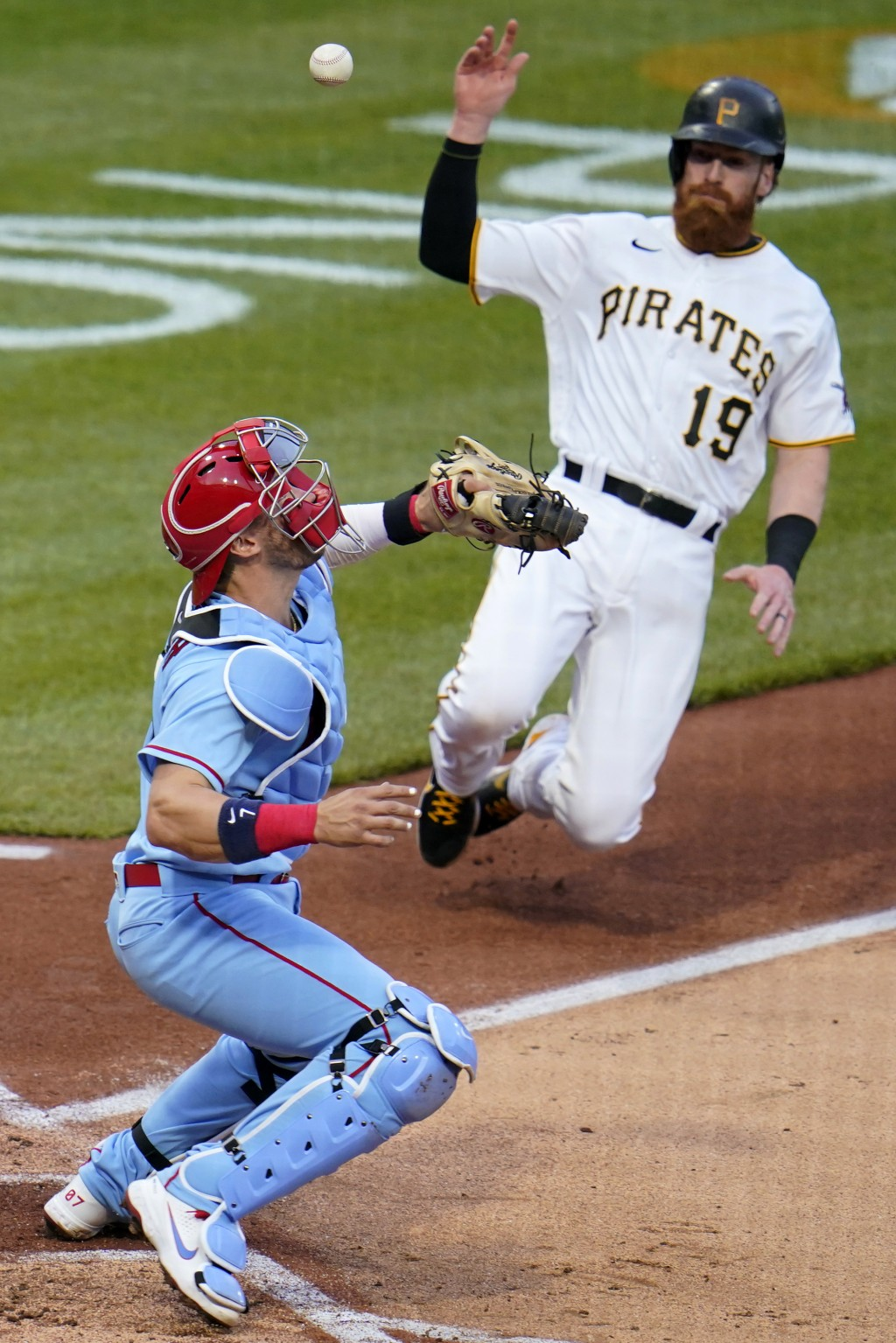 Pittsburgh Pirates' Colin Moran (19) scores on a sacrifice fly by Ka'ai Tom off St. Louis Cardinals starting pitcher Jack Flaherty, as Cardinals catch...