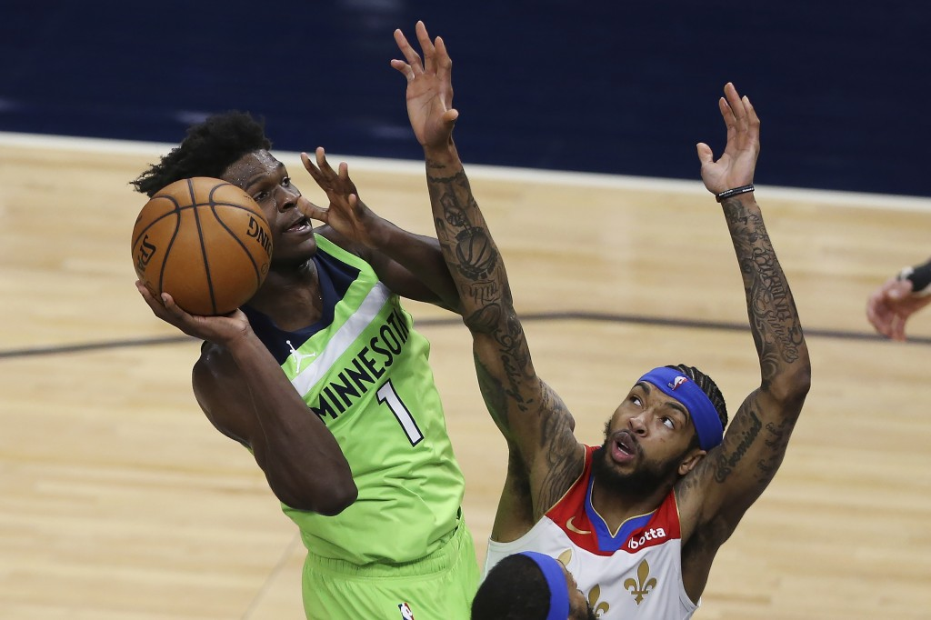 Minnesota Timberwolves' Anthony Edwards (1) goes up to the basket against New Orleans Pelicans' Brandon Ingram during the second half of an NBA basket...