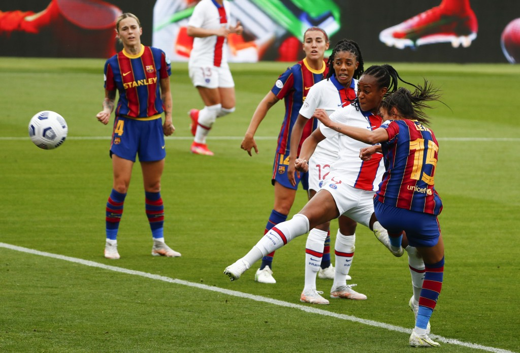 PSG's Marie-Antoinette Katoto, second right, scores her team's first goal during the Women's Champions League semifinal second leg soccer match betwee...