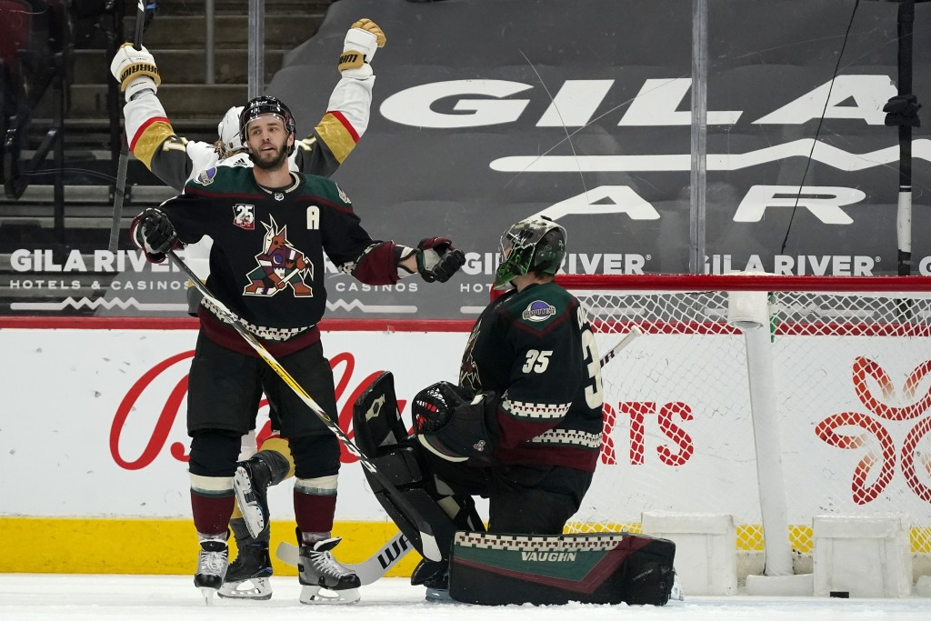 Arizona Coyotes goaltender Darcy Kuemper (35) and defenseman Niklas Hjalmarsson, front left, pause on the ice after a goal by Vegas Golden Knights cen...