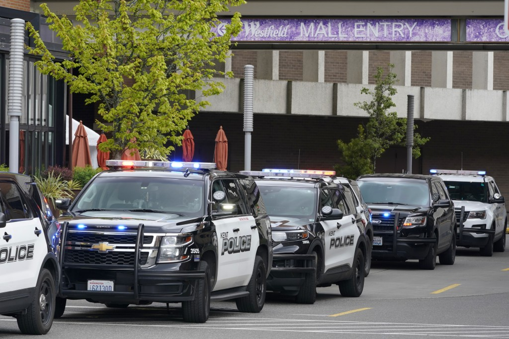 Police vehicles respond to a reported shooting, Saturday, May 1, 2021, at Southcenter Mall in Tukwila, Wash., south of Seattle. (AP Photo/Ted S. Warre...