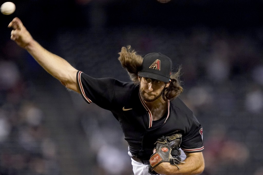 Arizona Diamondbacks starting pitcher Zac Gallen throws against the Colorado Rockies during the first inning of a baseball game, Saturday, May 1, 2021...